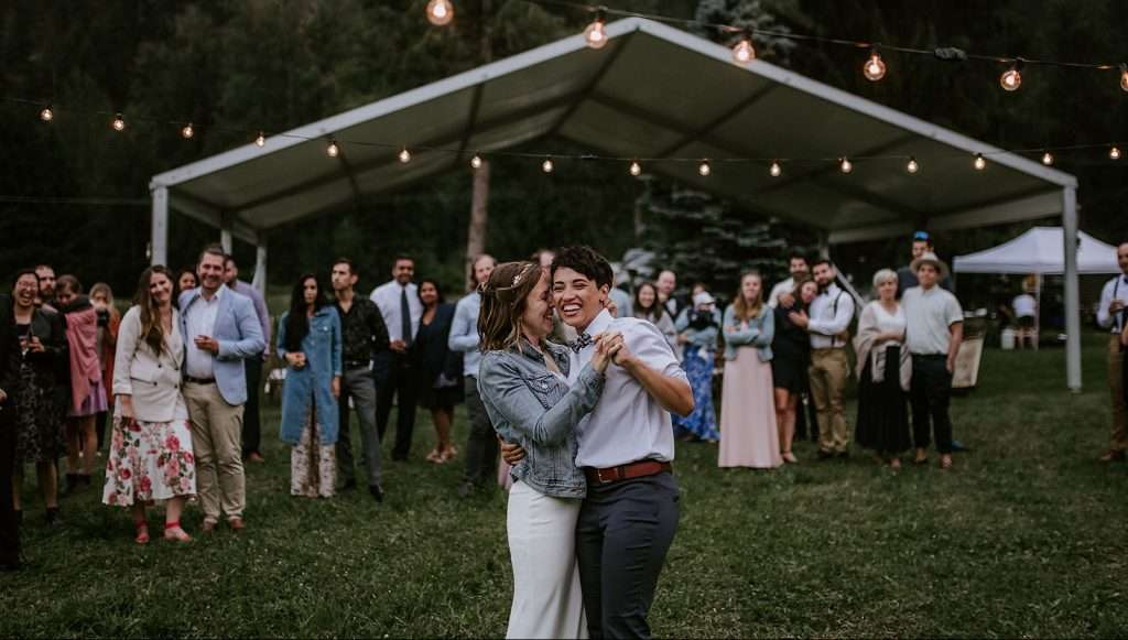 Two brides dancing at their wedding in Pemberton, BC.