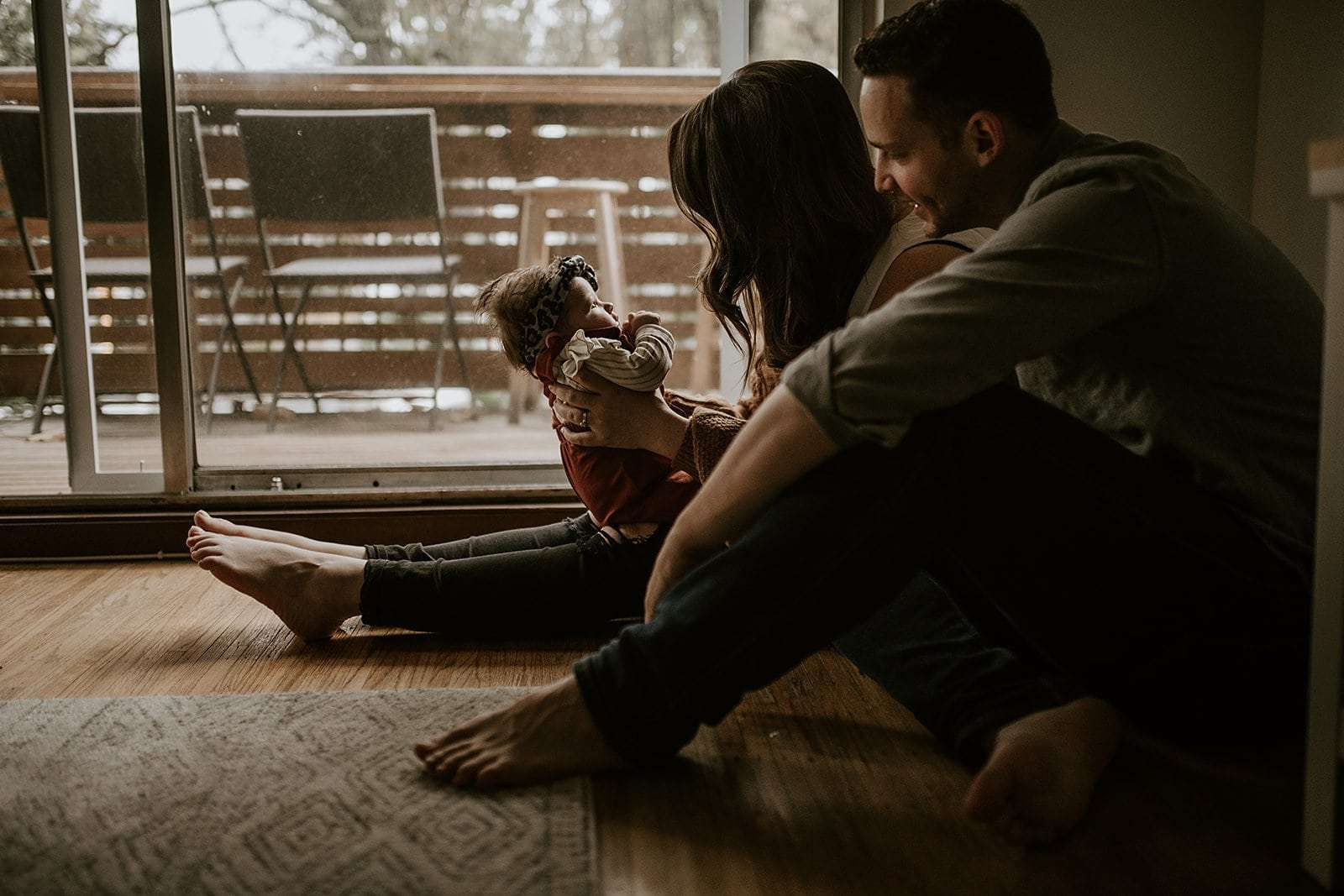 Couple at home at their newborn photography session.